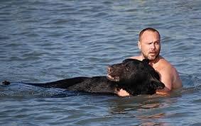 Adam Warwick with Bear