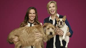 Hilary Swank and Jane Lynch with dogs