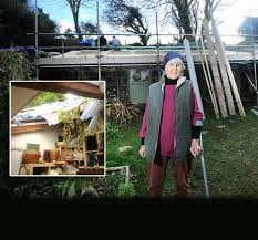 Sue Marshall in front of house