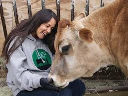 Ellie Laks with Cow