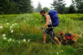 Man Hiking With Dog