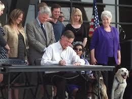 Governor John Hickenlooper signing bill