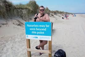 Olaf Danielson Birding Behind a Sign