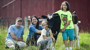 Tracey and Jon Stewart with children and animals
