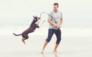 Rocky Kanaka with Dog at Beach
