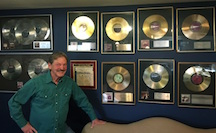 Terry Woodford with Platinum and Gold Records